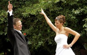Image of Bride and Groom dance at their reception.
