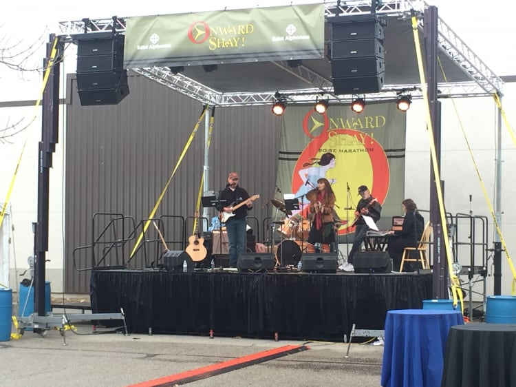Band on stage performs at race
