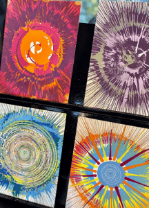 Image of spin art cards with colorful paint splatters.